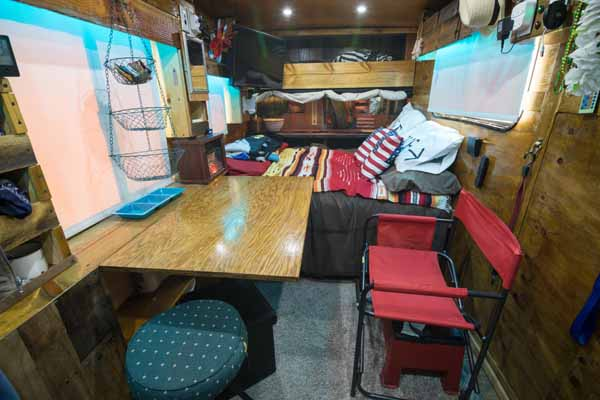 Cargo trailer conversion view to the back with flip up dining table up